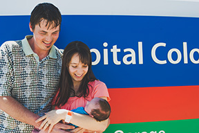 Noah's parents hold him in front of the Children's Hospital Colorado sign as they leave to take him home.