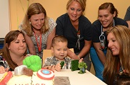 A young boy who is waiting for a heart transplant blows out the candles at his 5th birthday party at Children's Hospital Colorado.