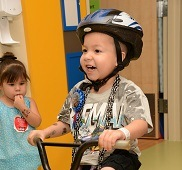 5-year-old Joshua (Junior) Montoya rides a bike around the hospital where he's been living while waiting for a new heart.
