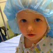 Isabella wears a surgical hair cover before surgery at Children's Hospital Colorado.