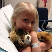 Isabella holds her teddy bear at Children's Hospital Colorado.