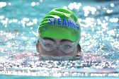 Children's Hospital Colorado cerebral palsy patient Paige swims in a pool.