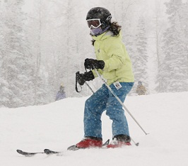 Children's Hospital Colorado cerebral palsy patient Paige skis on a mountain.