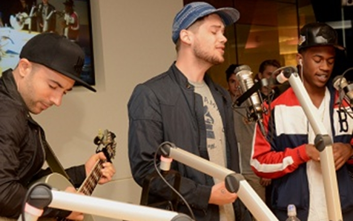 Three music artists perform at Seacrest Studios at Children's Colorado.