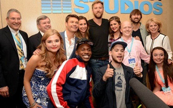 Ryan Seacrest, music artists and hospital administrators take a group photo at the opening of Seacrest Studios at Children's Colorado.