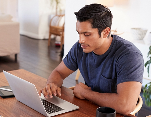 Man on computer researching prices