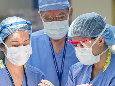 Three doctors work together in surgery.