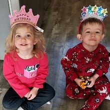 Emily and Tommy, who were treated for CDH at Children's Colorado, wear birthday tiaras.