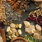 A array of foods including rice, dried cranberries, corn kernels, almonds, kidney beans and flaxseed.