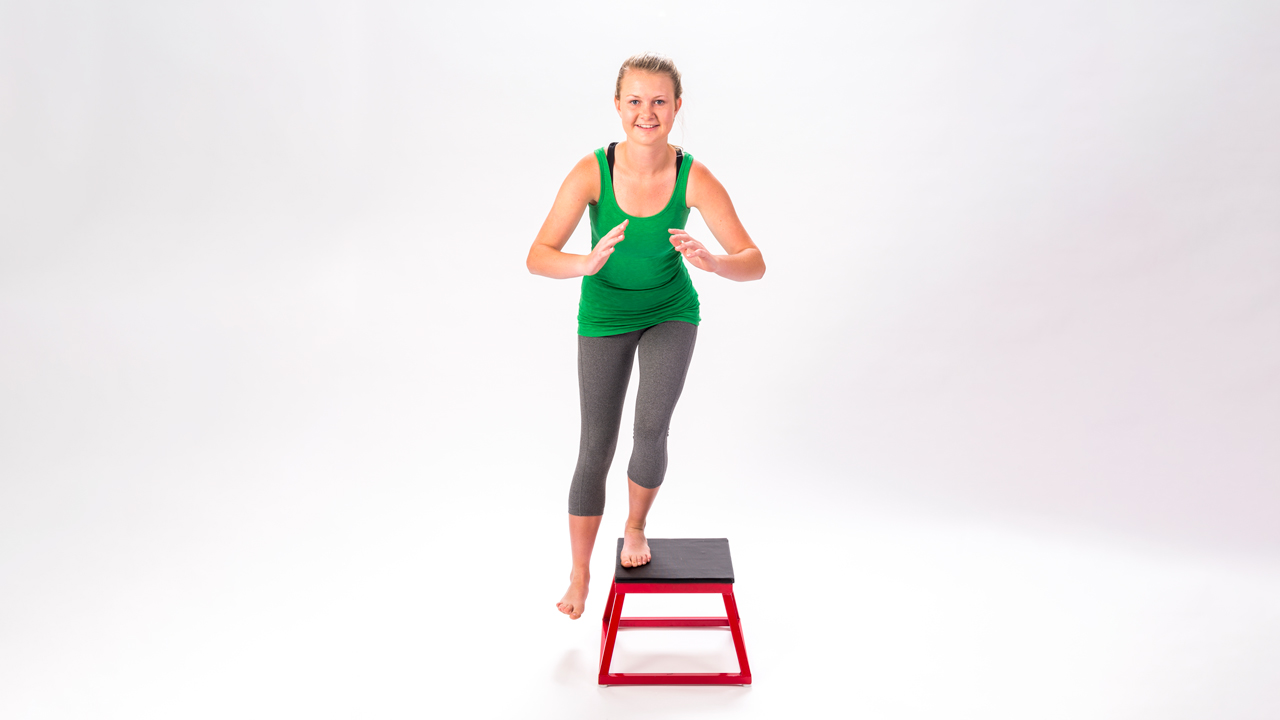 A teenager does balance and strengthening exercises