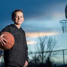 Young boy, Caleb, with a basketball.