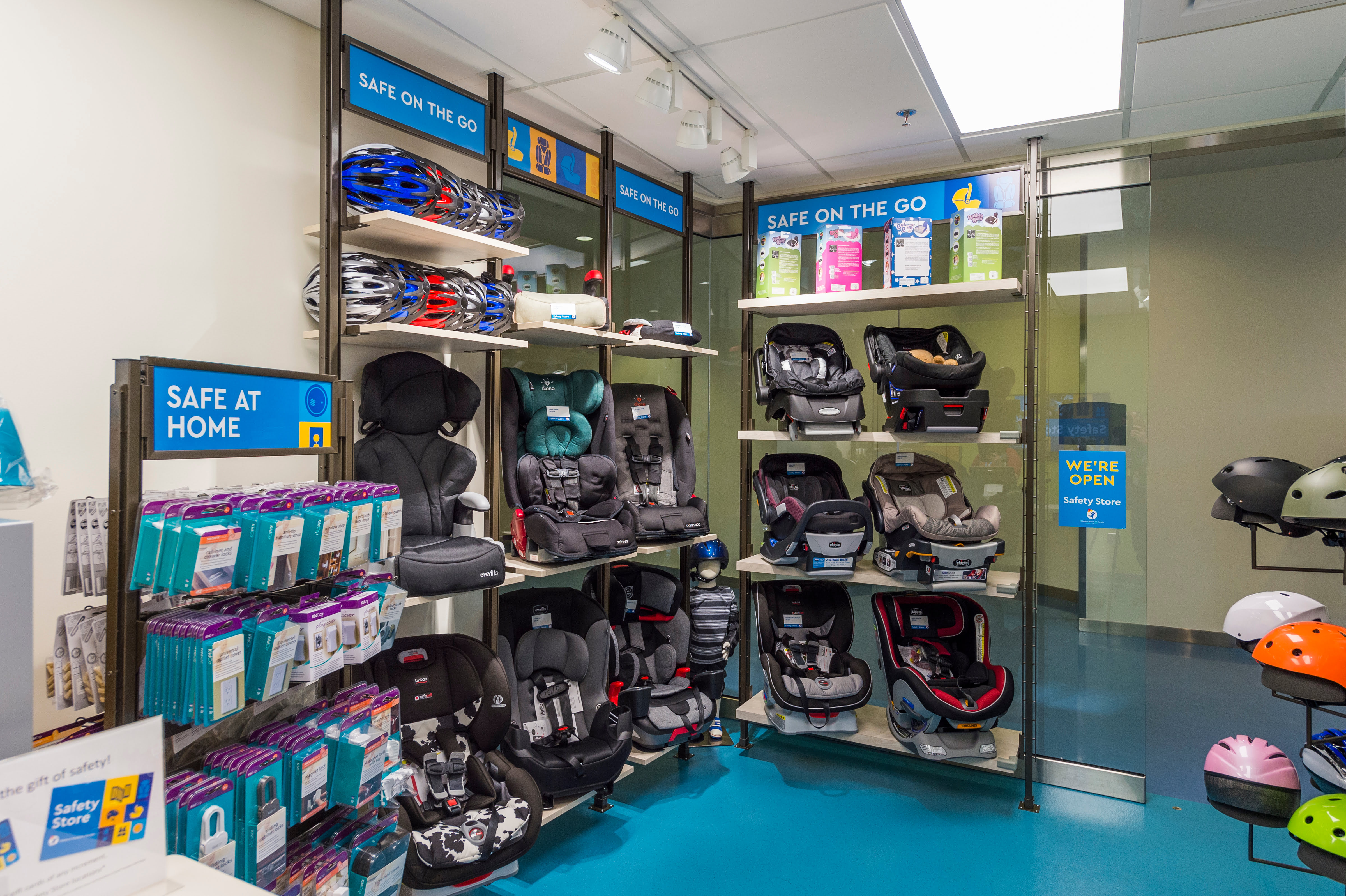 This is a look inside the Safety Store that shows a selection of car seats, helmets and other products on shelves.
