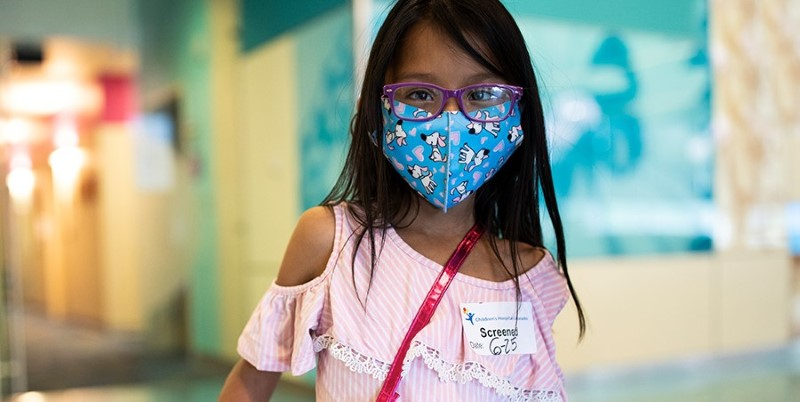 Girl wearing a mask.