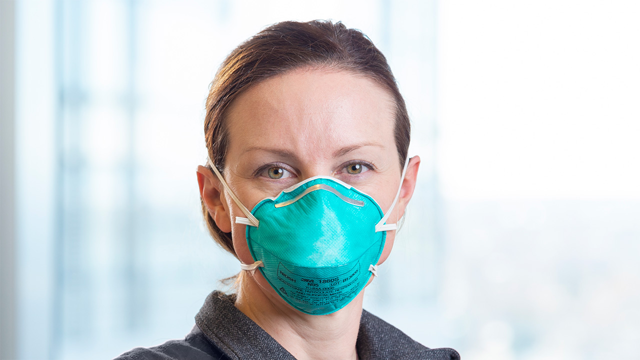 Woman wearing N-95 face mask in a hospital.