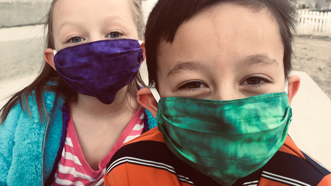 Two children wearing medical masks