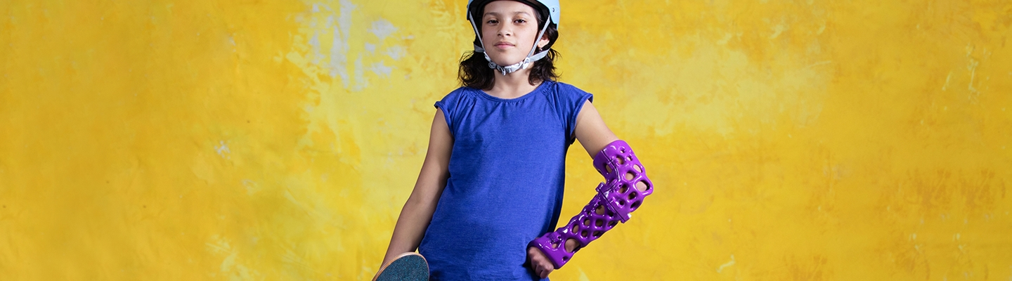 Skateboarding girl with a 3D cast on a yellow background.