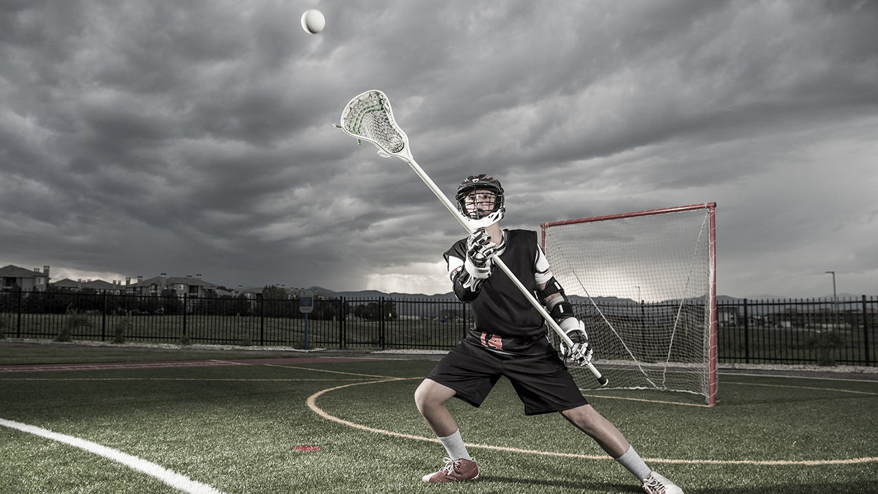 A lacrosse player catches the ball