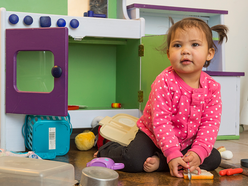 Amara, biliary atresia patient at Children's Hospital Colorado, plays in a toy kitchen.