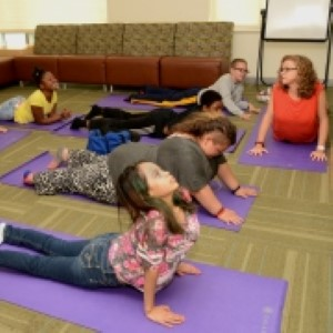 Michelle Fury (far right) leads patients through yoga exercises