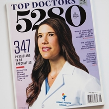 The cover of 5280 magazine with a photo of a female Children's Hospital Colorado doctor on it.
