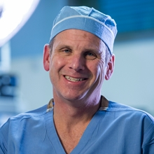 Dr. James Jaggers is shown in operation room scrubs