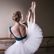 Ballerina and Children's Hospital Colorado scoliosis patient Caroline practices ballet at the bar.