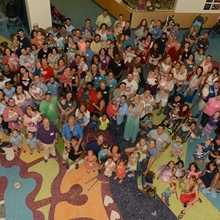 A gathering of former patients of the Colorado Fetal Care Center in the atrium of Children's Hospital Colorado.