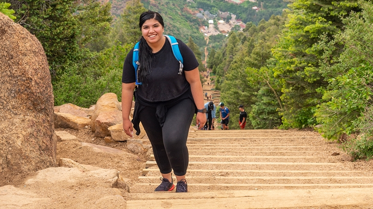 A girl climbing stairs after bariatric surgery