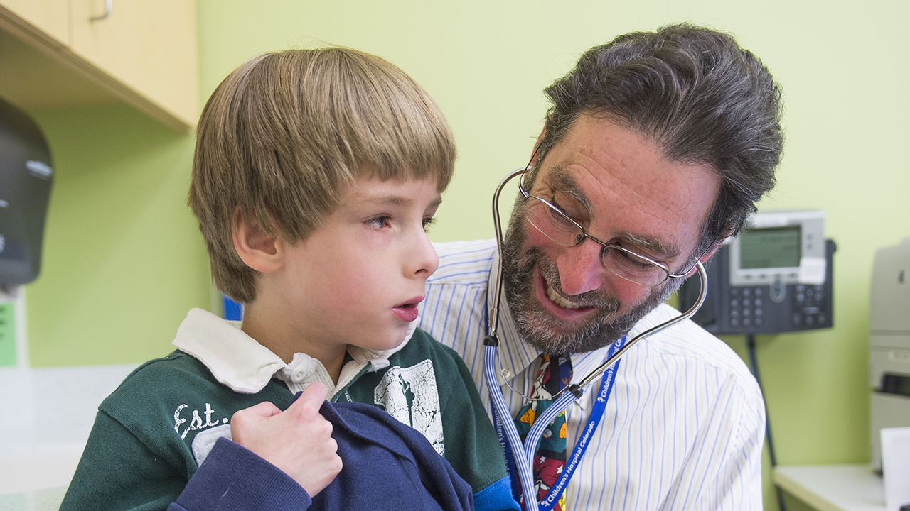A child is examined at the Inflammatory Bowel Disease Center