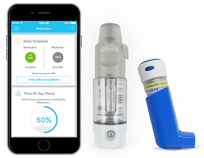 Photo showing the asthma monitoring device technology with mobile application, sensor and inhaler.