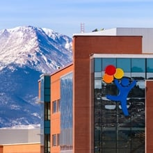 A photo showing the new Children's Hospital Colorado, Colorado Springs in front of the mountains.