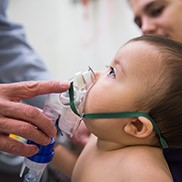 An infant receives oxygen in the Breathing Institute