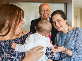 Pediatric colorectal surgeons Andrea Bischoff, MD, and Alberto Peña, MD, meet Linda Sibilia's son, Benjamin Nieto. Linda was born with a urogenital malformation called cloaca, which Dr. Peña reconstructed 30 years ago.