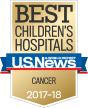 "A gold shield that says ""Best Children's Hospitals Cancer 2017-18"" with a blue and red ribbon across the middle that says ""U.S. News and World Report""."