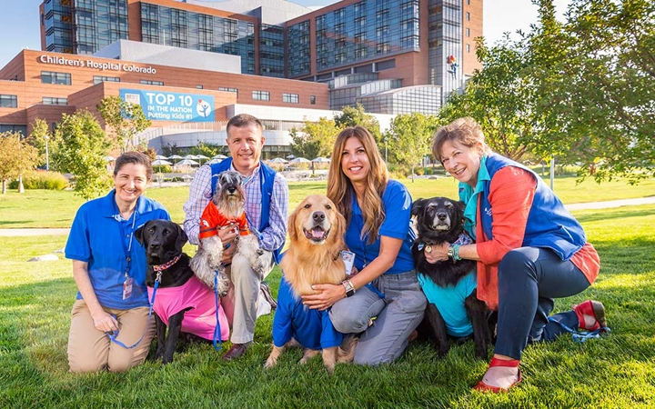 Prescription pets and their owners pose at Children's Hospital Colorado in Aurora.