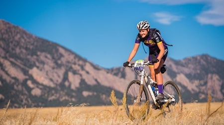 Martha Riedel bikes in the mountains