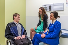 Jonathan Mackey in exam room with Dr. Andrea Bischoff and Julie Schlekter, nurse practitioner