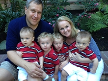The Cambruzzi family of mom, dad and four boys in matching red, black and white striped polos tell their story of twin-to-twin transfusion syndrome.