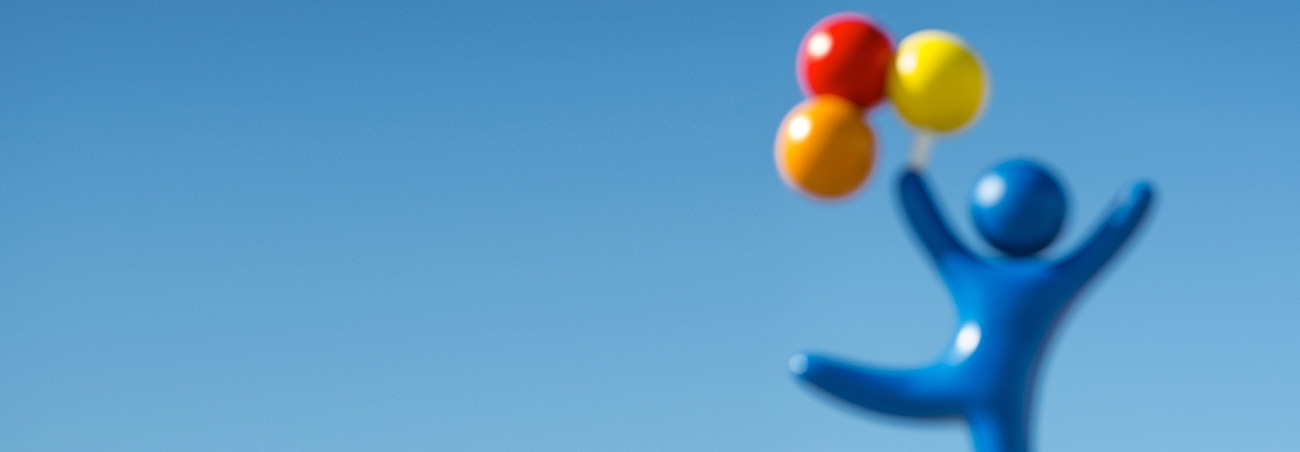 "A bright blue background with the ""balloon boy"" off center to the right. The balloon boy is a blue character who appears to be soaring by holding red, orange and yellow balloons above his head."
