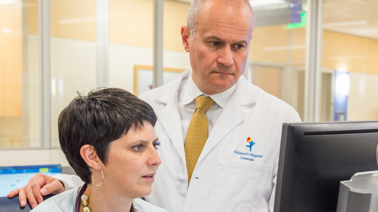 Megan Kelsey, MD, and Thomas Inge, MD, PhD, collaborate in their workroom in the Multidisciplinary Clinic.