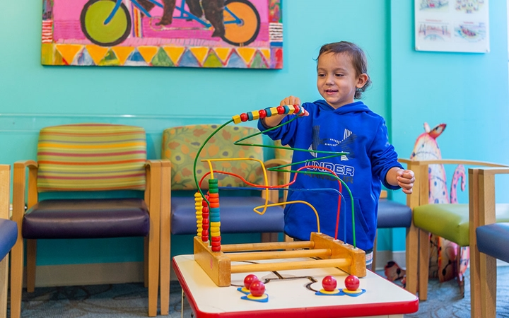 Patient playing in waiting room at Therapy Care, Broomfield
