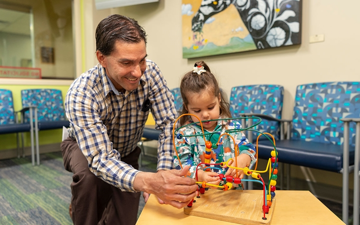 Children's Colorado Outpatient and Urgent Care, Wheat Ridge parent with child in waiting room