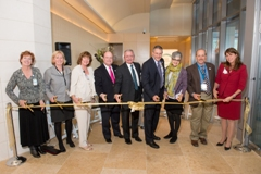 Nine professionals stand behind a ribbon, ready to cut, for the opening of the Colorado Institute for Maternal and Fetal Health tower at Children's Hospital Colorado.