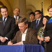 Colorado Governor Hickenlooper signs marijuana safe-packaging bill.