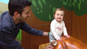 Charles Levaque plays with his daughter, 1-year-old Olivia, at Children's Hospital Colorado