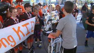 12-year-old Jackson Simpson was visited by his team after winning the state championship. Image credit: CBS4
