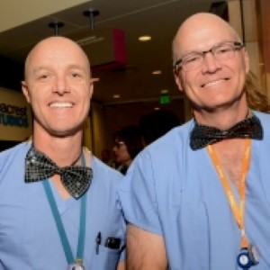 Ryan Ballard (left), physician assistant, and Dr. Mark Erickson (right), chair of orthopedic surgery, wear black bow ties during the celebration event.