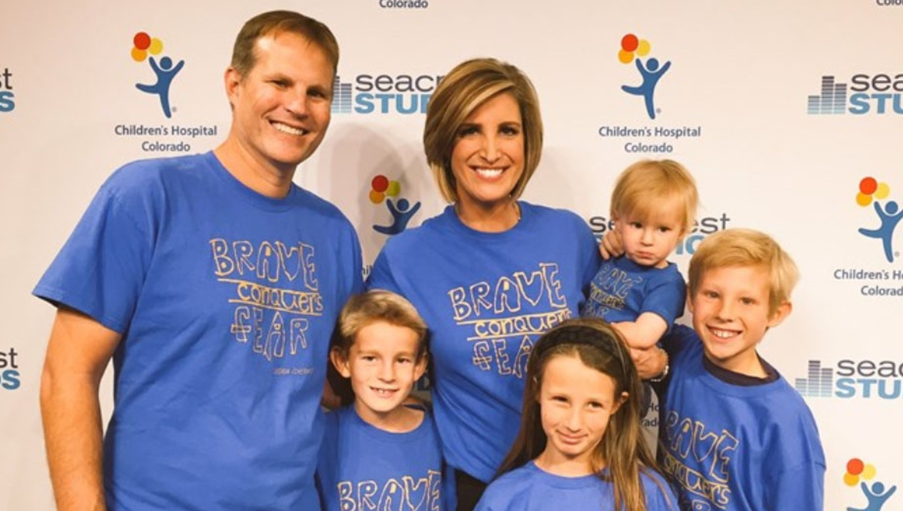A family wearing Brave Conquers Fear shirts at a Children's Hospital Colorado event.
