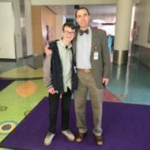 Kaine Greathouse (left) stands with Dr. Martin Runciman, a pediatric cardiologist at Children's Hospital Colorado