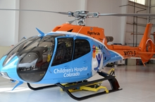 children's hospital colorado, helicopter, flight for life, centura health, blue, orange, white, yellow, logo, hanger, on ground, rocky mountain region, colorado, healthcare
